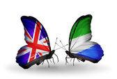 Twee vlinders met vlaggen op vleugels als symbool van de betrekkingen, uk en sierra leone — Stockfoto