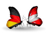 Two butterflies with flags on wings as symbol of relations Germany and Austria — Stock Photo