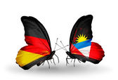 Two butterflies with flags on wings as symbol of relations Germany and Antigua and Barbuda — Stock Photo