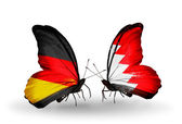 Two butterflies with flags on wings as symbol of relations Germany and Bahrain — Stock Photo