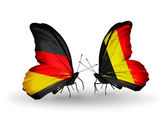 Two butterflies with flags on wings as symbol of relations Germany and Belgium — Stock Photo
