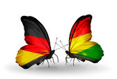 Two butterflies with flags on wings as symbol of relations Germany and Bolivia — Stock Photo