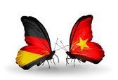 Two butterflies with flags on wings as symbol of relations Germany and Vietnam — Stock Photo