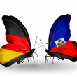 Two butterflies with flags on wings as symbol of relations Germany and Haiti — Stock Photo #32731757