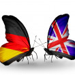 Two butterflies with flags on wings as symbol of relations Germany and UK — Stock Photo #32731759