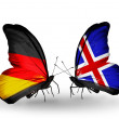 Two butterflies with flags on wings as symbol of relations Germany and Iceland — Stock Photo #32731869