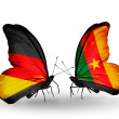 Two butterflies with flags on wings as symbol of relations Germany and Cameroon — Stockfoto