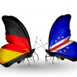 Two butterflies with flags on wings as symbol of relations Germany and Cape Verde — Stock Photo #32731911