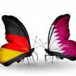Two butterflies with flags on wings as symbol of relations Germany and Qatar — Stock Photo #32731917