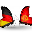 Two butterflies with flags on wings as symbol of relations Germany and Kirghiz — Stock Photo #32731929