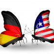 Two butterflies with flags on wings as symbol of relations Germany and Liberia — Stock Photo #32731979