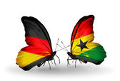 Two butterflies with flags on wings as symbol of relations Germany and Ghana — Stock Photo