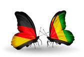 Two butterflies with flags on wings as symbol of relations Germany and Guinea — Stock Photo