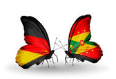 Two butterflies with flags on wings as symbol of relations Germany and Grenada — Stock Photo