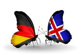 Two butterflies with flags on wings as symbol of relations Germany and Iceland — Stock Photo