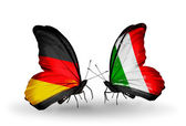 Two butterflies with flags on wings as symbol of relations Germany and Italy — Stock Photo
