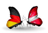 Two butterflies with flags on wings as symbol of relations Germany and Latvia — Stock Photo