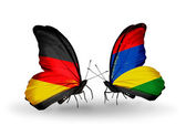 Two butterflies with flags on wings as symbol of relations Germany and Mauritius — Stock Photo