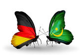 Two butterflies with flags on wings as symbol of relations Germany and Mauritania — Stock Photo