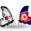 Two butterflies with flags on wings as symbol of relations South Korea and North Korea — Stockfoto
