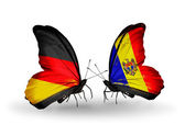 Two butterflies with flags on wings as symbol of relations Germany and Moldova — Stock Photo