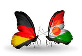 Two butterflies with flags on wings as symbol of relations Germany and Niger — Stock Photo