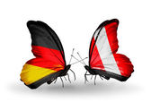 Two butterflies with flags on wings as symbol of relations Germany and Peru — Stock Photo