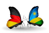 Two butterflies with flags on wings as symbol of relations Germany and Rwanda — Stock Photo