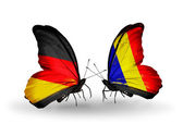 Two butterflies with flags on wings as symbol of relations Germany and Chad, Romania — Stock Photo
