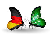 Two butterflies with flags on wings as symbol of relations Germany and Saudi Arabia — Stock Photo