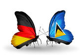 Two butterflies with flags on wings as symbol of relations Germany and Saint Lucia — Stock fotografie