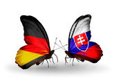 Two butterflies with flags on wings as symbol of relations Germany and Slovakia — Stock Photo