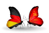 Two butterflies with flags on wings as symbol of relations Germany and Soviet Union — Stock Photo