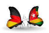 Two butterflies with flags on wings as symbol of relations Germany and Togo — Stock Photo
