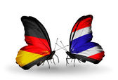 Two butterflies with flags on wings as symbol of relations Germany and Thailand — Stock Photo