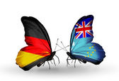 Two butterflies with flags on wings as symbol of relations Germany and Tuvalu — Stok fotoğraf