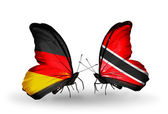 Two butterflies with flags on wings as symbol of relations Germany and Trinidad and Tobago — Stock Photo