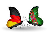 Two butterflies with flags on wings as symbol of relations Germany and Turkmenistan — Stock Photo