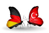 Two butterflies with flags on wings as symbol of relations Germany and Turkey — Stock Photo