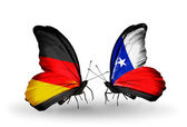 Two butterflies with flags on wings as symbol of relations Germany and Chile — Stock Photo
