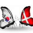 Stock Photo: Two butterflies with flags on wings as symbol of relations South Koreand Denmark