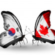 Two butterflies with flags on wings as symbol of relations South Korea and Canada — Stock Photo