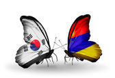 Two butterflies with flags on wings as symbol of relations South Korea and Armenia — Stockfoto