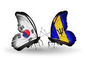 Two butterflies with flags on wings as symbol of relations South Korea and Barbados — ストック写真