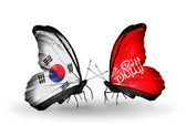 Two butterflies with flags on wings as symbol of relations South Korea and Waziristan — Stock Photo