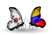 Two butterflies with flags on wings as symbol of relations South Korea and Venezuela — Stockfoto