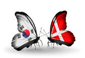 Two butterflies with flags on wings as symbol of relations South Korea and Denmark — Stock Photo