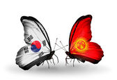 Two butterflies with flags on wings as symbol of relations South Korea and Kirghiz — Stockfoto