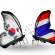 Two butterflies with flags on wings as symbol of relations South Korea and Thailand — Stock Photo