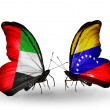 Two butterflies with flags on wings as symbol of relations UAE and Venezuela — Stock Photo